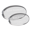 Clear oval shaped acrylic paperweight shown with two sizes