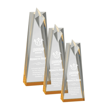 Cast Star Acrylic Award with free standing gold tinted base shown with three sizes